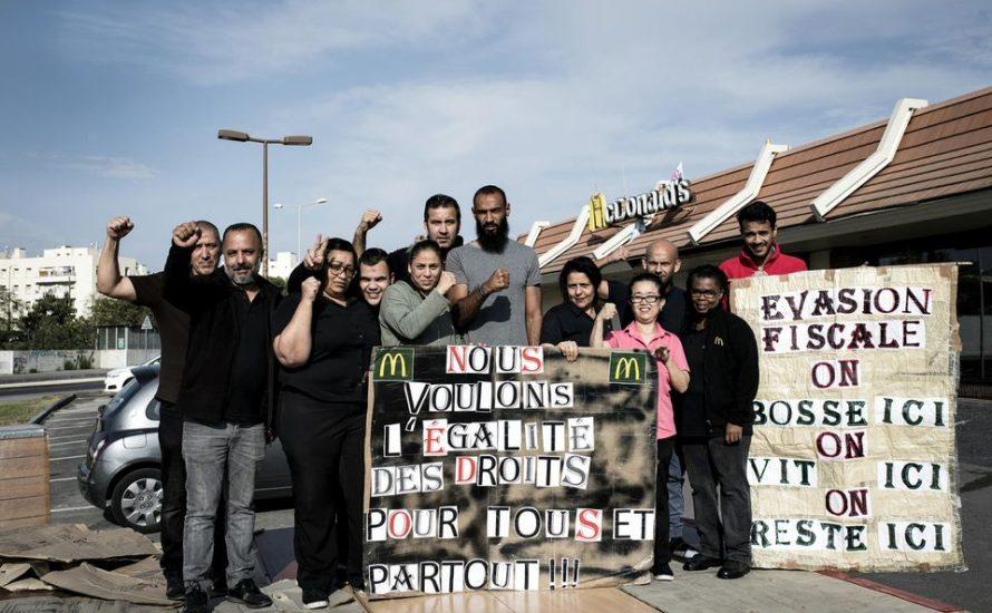 McDonald's-Filiale besetzt: Arbeiter*innen verteilen Lebensmittelpakete an Leidtragende der Krise